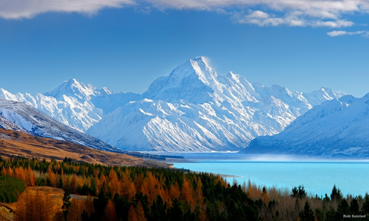 38773AM00: Aoraki / Mount Cook (3754m) and Lake Pukaki in winter. Mt La Perouse (3078m) left, Tasman Valley and Burnett Mountains Range right. Panorama with late autumn colours, Aoraki / Mount Cook National Park, MacKenzie District, New Zealand. Photocred